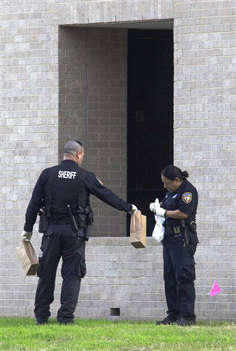 "<div class=""meta image-caption""><div class=""origin-logo origin-image ""><span></span></div><span class=""caption-text"">Police collect evidence after a shooting happened on Lone Star College North Harris campus on Tuesday January 22, in Houston. The shooting at a community college wounded three people Tuesday and sent some students fleeing for safety while others with medical training helped tend the wounded.    (AP Photo/ Patric Schneider)</span></div>"