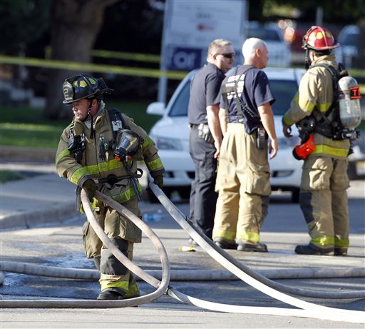 "<div class=""meta image-caption""><div class=""origin-logo origin-image ""><span></span></div><span class=""caption-text"">Firefighter work in front of an apartment where the suspect in a theatre shooting lived in Aurora, Colo., on Friday, July 20, 2012. As many as 12 people were killed and 50 injured at a shooting at the Century 16 movie theatre on Friday. The suspect is identified as 24-year-old James Holmes. (AP Photo/Ed Andrieski)</span></div>"
