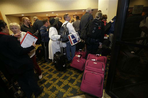 "<div class=""meta image-caption""><div class=""origin-logo origin-image ""><span></span></div><span class=""caption-text"">Passengers from the disabled Carnival Triumph cruise ship arrive by bus at the Hilton Riverside Hotel in New Orleans, Friday, Feb. 15, 2013. The ship had been idled for nearly a week in the Gulf of Mexico following an engine room fire. (AP photo)</span></div>"