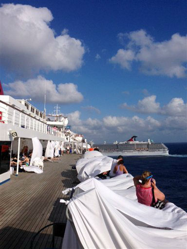 This Sunday, Feb. 10, 2013 photo, provided by Kalin Hill, of Houston, shows passengers with makeshift tents on the the deck of the Carnival Triumph cruise ship at sea in the Gulf of Mexico. The ship nearing Mobile Bay is without engine power and is being towed by tugboats.   <span class=meta>(AP Photo&#47; Kalin Hill)</span>