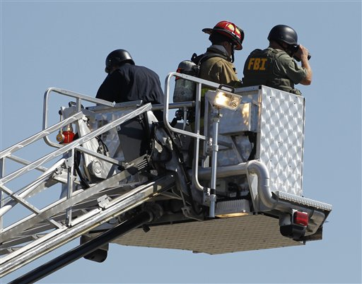 "<div class=""meta ""><span class=""caption-text "">Police use the bucket on a fire truck to look down on an apartment where the suspect in a theatre shooting lived in Aurora, Colo., on Friday, July 20, 2012. As many as 12 people were killed and 50 injured at a shooting at the Century 16 movie theatre on Friday. The suspect is identified as 24-year-old James Holmes. (AP Photo/Ed Andrieski)</span></div>"