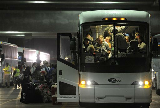 Passengers of the Carnival Triumph walk to their buses after docking at the cruise terminal in Mobile, Ala., Thursday, Feb. 14, 2013. The passengers will be bused to New Orleans for the night. The ship with more than 4,200 passengers and crew members has been idled for nearly a week in the Gulf of Mexico following an engine room fire.  <span class=meta>(AP photo)</span>