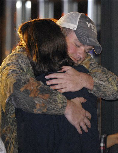 "<div class=""meta ""><span class=""caption-text "">James Enmon hugs his aunt Kristi Conn, both of Orange, Texas, after getting off the cruise ship Carnival Triumph in Mobile, Ala., Thursday, Feb. 14, 2013. The ship with more than 4,200 passengers and crew members has been idled for nearly a week in the Gulf of Mexico following an engine room fire.   (AP photo)</span></div>"