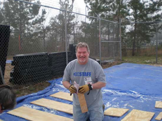 Volunteers, including some you might recognize, got down and dirty to set up for Friday's playground build at KIPP Legacy Preparatory School in northeast Houston.