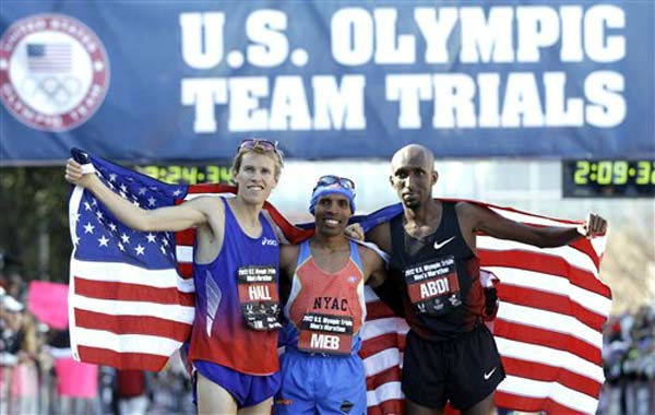 "<div class=""meta ""><span class=""caption-text "">The top three men finishers, Ryan Hall, left, second, Meb Keflezighi, center, first, and Abdi Abdirahman, third, pose after the U.S. Olympic Trials Marathon, Saturday, Jan. 14, 2012, in Houston. (AP Photo/David J. Phillip) (AP Photo/ David J. Phillip)</span></div>"