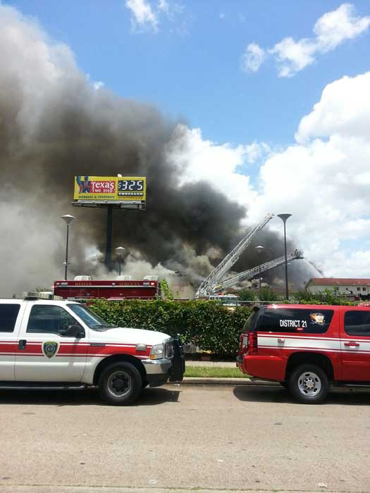 "<div class=""meta image-caption""><div class=""origin-logo origin-image ""><span></span></div><span class=""caption-text"">Firefighters are busy battling a massive fire at a southwest Houston hotel (iWitness Reports)</span></div>"