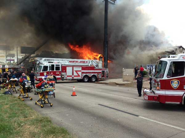 Firefighters are busy battling a massive fire at a southwest Houston hotel