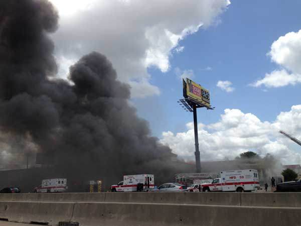 "<div class=""meta ""><span class=""caption-text "">Firefighters are busy battling a massive fire at a southwest Houston hotel</span></div>"