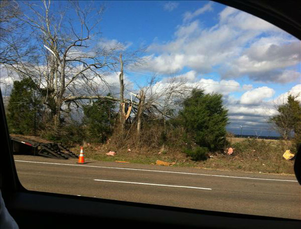 "<div class=""meta ""><span class=""caption-text "">An iWitness user captures the damage caused along Highway 287 near Groveton after a strong weather system blew into southeast Texas on Christmas morning. (KTRK Photo)</span></div>"