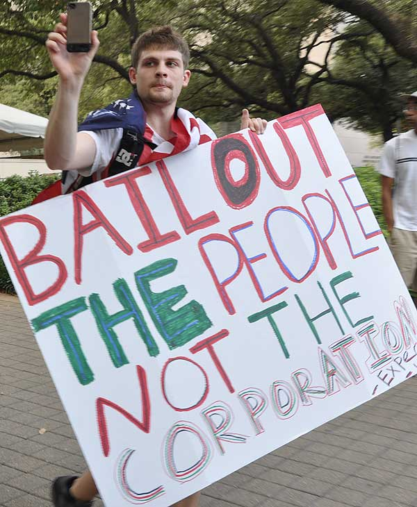 Houston protesters join the Occupy movement to...