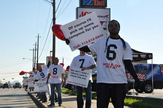 "<div class=""meta ""><span class=""caption-text "">Single men wanting dates on Valentine's Day spent the morning lined up on a stretch of Westheimer with numbered signs.  Interested ladies driving by called in to the Rod Ryan radio show to land a date. (Photo/ABC13)</span></div>"