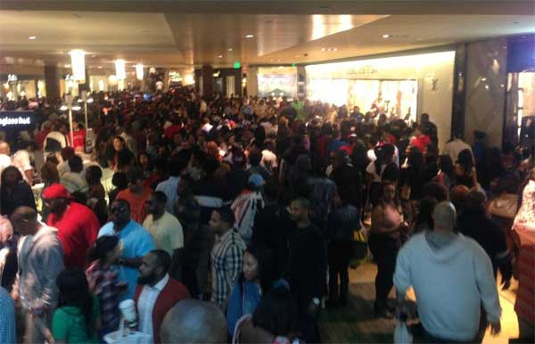 An iWitness user documents the massive crowds at the Houston Galleria. The overcrowding prompted officials to close down the mall early as a precaution  on Saturday.