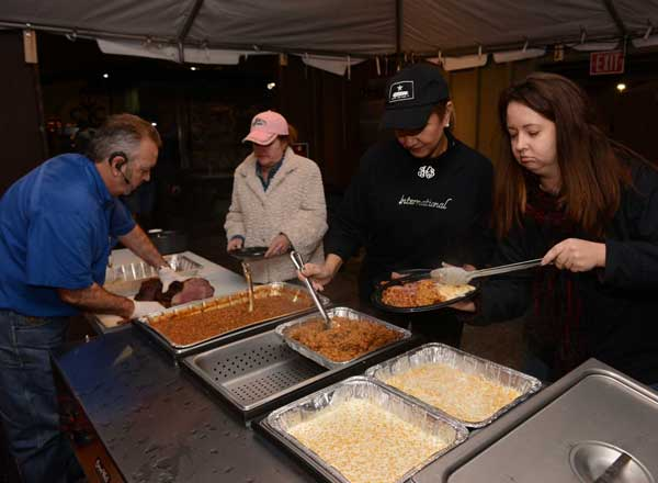 "<div class=""meta ""><span class=""caption-text "">It was all about the barbecue Wednesday night, as cooks converged at Reliant Park to prepare for the Houston Livestock Show and Rodeo BBQ Cookoff and eat some good food. (John Mizwa, KTRK Photographer)</span></div>"