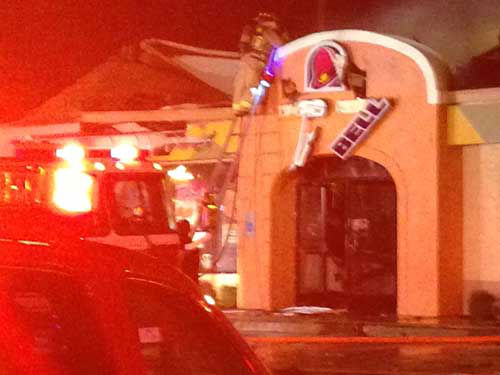 Firefighters battle a blaze at Taco Bell in west Houston while high winds fuel the flames <span class=meta>(KTRK Photo)</span>