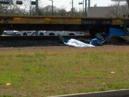 A train smashed into an 18-wheeler in the Magnolia area Monday. Do you have photos or video? Send them to news@abc13.com. <span class=meta>(KTRK Photo&#47; iWitness Reports)</span>