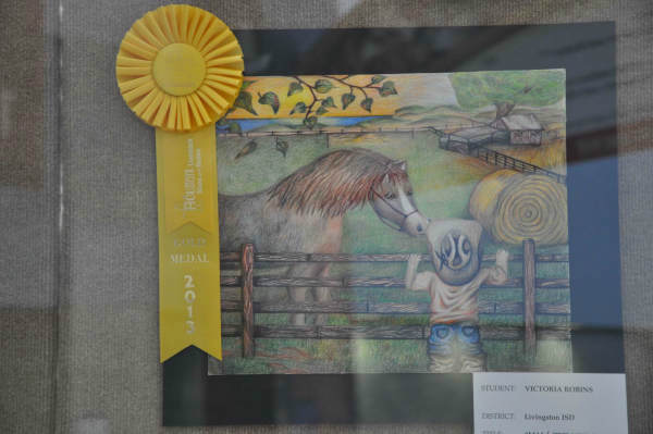 "<div class=""meta image-caption""><div class=""origin-logo origin-image ""><span></span></div><span class=""caption-text"">Many students from different school districts had their Houston Livestock Show and Rodeo art work displayed at the Reliant Center. (Photo/ABC-13)</span></div>"