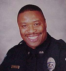 Lt. Dennis Walker, 47, was taken by helicopter to Memorial Hermann Hospital with a gunshot wound to his chest.