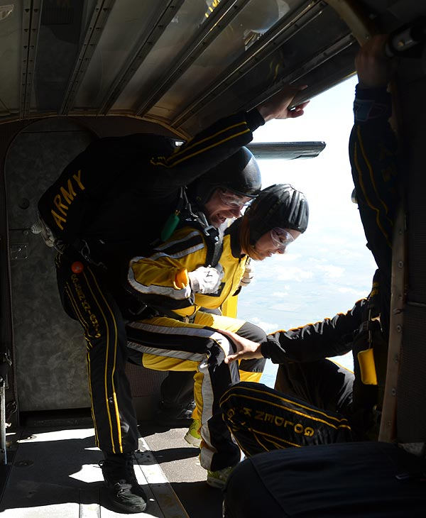 "<div class=""meta ""><span class=""caption-text "">ABC-13 Meteorologist Casey Curry took part of a tandem jump with the US Army Golden Knights.  Several others also took the training class before they took the plunge with the elite parachuting team.  ( ABC-13)</span></div>"