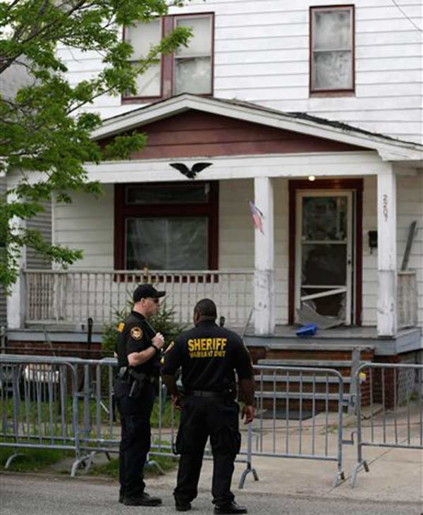 "<div class=""meta ""><span class=""caption-text "">Sheriff deputies stand outside a house in Cleveland Tuesday, May 7, 2013, the day after three women who vanished a decade ago were found there. Amanda Berry, Gina DeJesus and Michelle Knight, who went missing separately about a decade ago, were found in the home just south of downtown Cleveland and likely had been tied up during years of captivity, said police, who arrested three brothers. (AP Photo/Tony Dejak) (Tony Dejak)</span></div>"