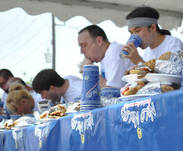 "<div class=""meta ""><span class=""caption-text "">These are photos from the sixth annual Niko Niko's World Gyro Eating Championship Sunday, May 19, 2013, at the Greek Festival in west Houston.  Top-ranked competitive eater Joey Chestnut won with 22 1/4 gyros consumed in 10 minutes.  Second place was Matt Stonie. (Photo/ABC13)</span></div>"