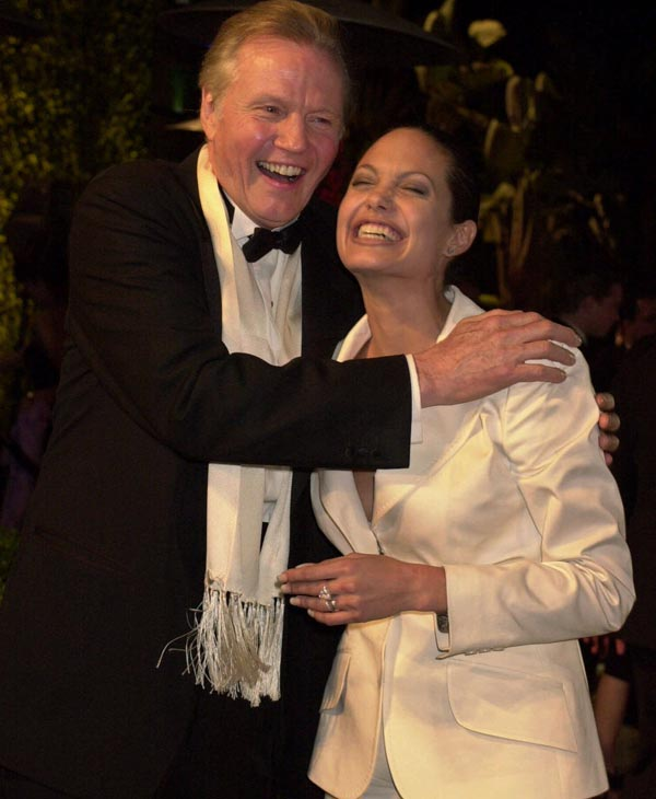 Jon Voight and his daughter Angelina Jolie laugh at the Vanity Fair Oscar party at Morton&#39;s in Hollywood on March 25, 2001. &#40;AP Photo&#47;Laura Rauch&#41; <span class=meta>(AP Photo)</span>