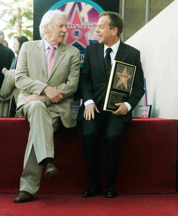 Kiefer Sutherland poses with his father, actor Donald Sutherland, during dedication ceremonies for Kiefer Sutherland&#39;s star on the Hollywood Walk of Fame in Los Angeles Tuesday, Dec. 9, 2008. &#40;AP Photo&#47;Reed Saxon&#41; <span class=meta>(AP Photo)</span>