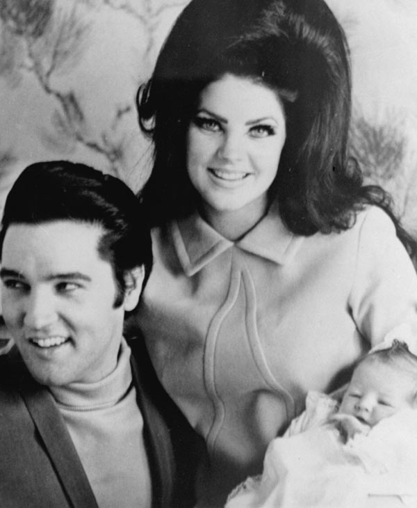 "<div class=""meta image-caption""><div class=""origin-logo origin-image ""><span></span></div><span class=""caption-text"">Elvis Presley is shown on Feb. 5, 1968 with his wife Priscilla and their newly born daughter, Lisa Marie. (AP Photo) (AP Photo)</span></div>"