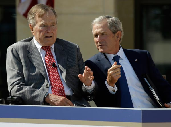 Former President George W. Bush, right, talks with his father, former President George H.W. Bush during the dedication of the George W. Bush Presidential Center, Thursday, April 25, 2013, in Dallas. &#40;AP Photo&#47;David J. Phillip&#41; <span class=meta>(AP Photo)</span>