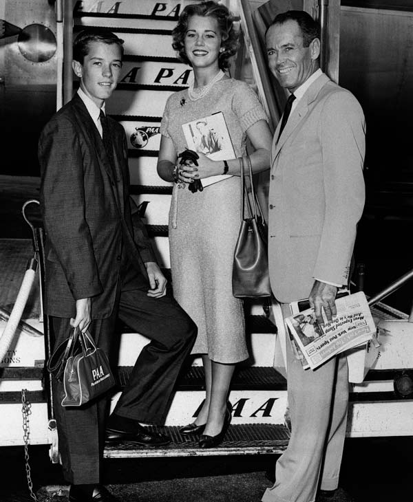 In this June 25, 1957 file photo, movie actor Henry Fonda, right, with his children, Jane and Peter, are shown at New York International Airport boarding a clipper airplane for Europe where they&#39;ll spend the summer seeing sights. On on Saturday, April 27, 2013, Jane Fonda, the 75-year-old Oscar winner , will place her hand and footprints next to her father&#39;s in the concrete shrine to celebrity outside Hollywood&#39;s TCL Chinese Theatre. Then she&#39;ll present a special screening of the film she made with her dad, &#34;On Golden Pond.&#34; The cement and cinematic tribute is part of the 2013 TCM Classic Film Festival, which is honoring Jane Fonda.&#40;AP Photo, File&#41;  <span class=meta>(AP Photo)</span>