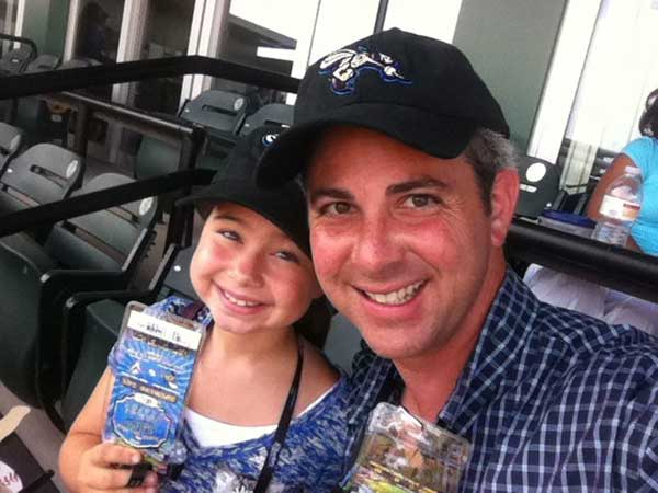 "<div class=""meta ""><span class=""caption-text "">Reporter and Father Kevin Quinn and his daughter taking in a Skeeters game</span></div>"