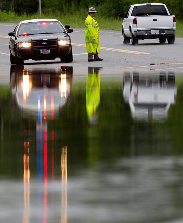 "<div class=""meta image-caption""><div class=""origin-logo origin-image ""><span></span></div><span class=""caption-text"">A Florida Highway Patrolman warns motorists about high water in Medart, Fla., Tuesday, June 26, 2012. Heavy rains from the approaching Tropical Storm Debby caused wind and rain damage. (AP Photo/Dave Martin)</span></div>"