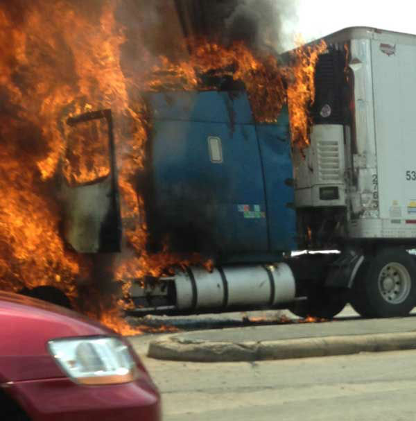 "<div class=""meta image-caption""><div class=""origin-logo origin-image ""><span></span></div><span class=""caption-text"">These are photos from a viewer of a big rig on fire near the intersection of West Bellfort at Braesridge Wednesday afternoon.  If you see news happening, email photos or video to us at news@abc13.com (Photo/iWitness Reports)</span></div>"