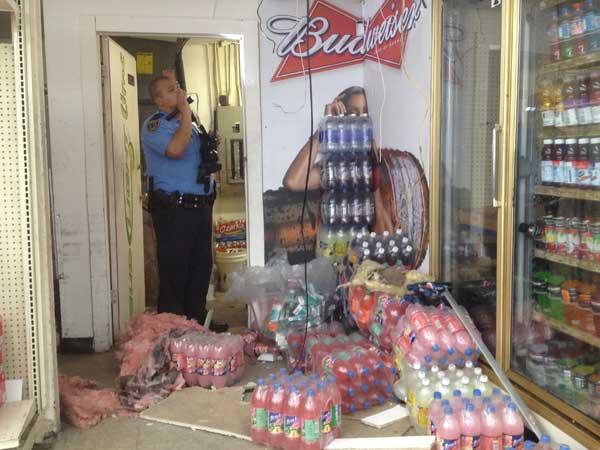 "<div class=""meta image-caption""><div class=""origin-logo origin-image ""><span></span></div><span class=""caption-text"">Two suspected burglars were caught by police but not before they made a big mess inside a local store (John Mizwa)</span></div>"