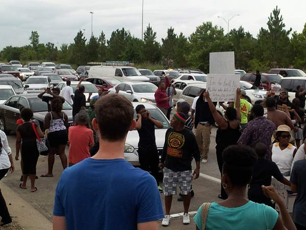 "<div class=""meta ""><span class=""caption-text "">Hundreds in Houston gathered to protest the acquittal of George Zimmerman in the Trayvon Martin shooting. They marched down the street and at one point blocked Highway 288 as they marched across the highway yesterday.  If you've got photos, send them to us at news@abc13.com and we'll post them all on our iWitness Reports page. (Photo/iWitness Reports)</span></div>"