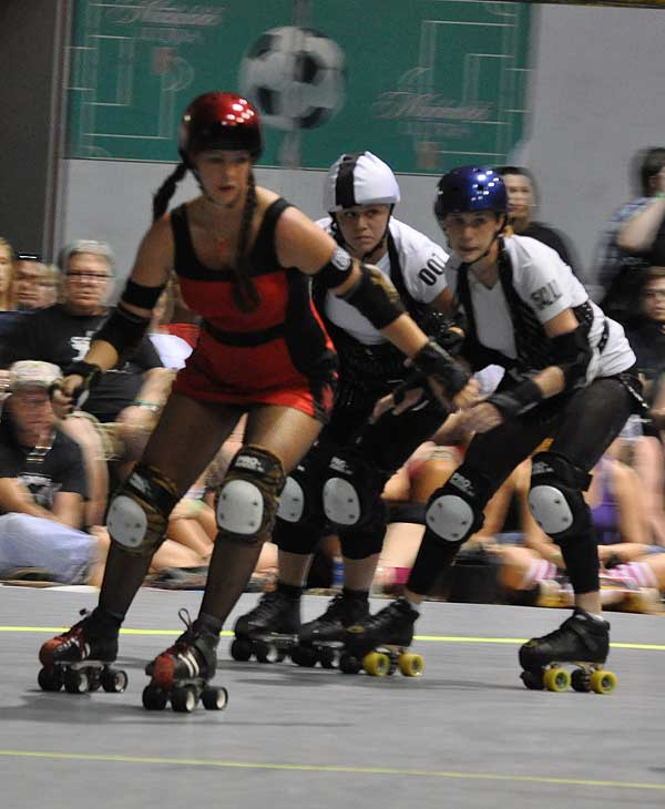 The Houston Roller Derby heated up the rink at KICKS Indoor Soccer facility on Saturday, July 17, 2010, as Houston's Brawlers took on the Hustlers from Austin, followed by a bout between the Bayou City Bosses and the Psych Ward Sirens.  For more information on the teams and athletes, visit Houston Roller Derby's website.