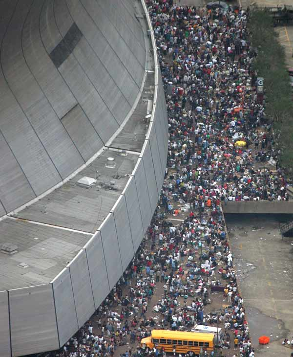 Residents wait to be evacuated from the Louisianna Superdome Thursday, Sept. 1, 2005 in New Orleans. (AP Photo/David J. Phillip, Pool)