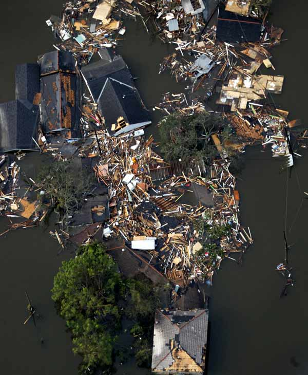 Homes destroyed by floodwaters from Hurricane Katrina are shown in this aerial view Tuesday, Aug. 30, 2005 in New Orleans. Hurricane Katrina did extensive damage when it made landfall on Aug. 29, 2005. (AP Photo/David J. Phillip)