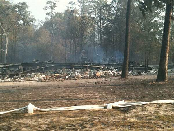 Resident John Burton took photos of the destruction left behind after a wildfire tore through his Magnolia area neighborhood. <span class=meta>(John Burton)</span>