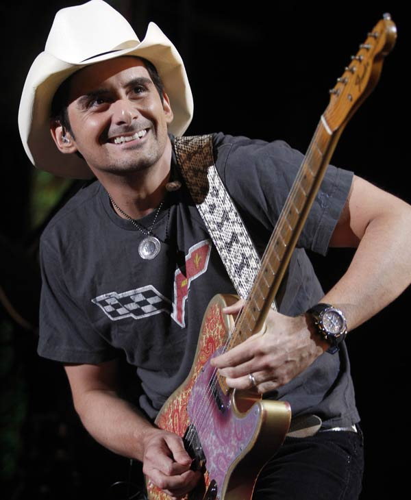 "In this June 9, 2011 file photo, Brad Paisley performs during the CMA Fan Festival in Nashville, Tenn. Paisley is releasing his first book on Nov. 1 called ""Diary of a Player"". (AP Photo/Wade Payne, file)"