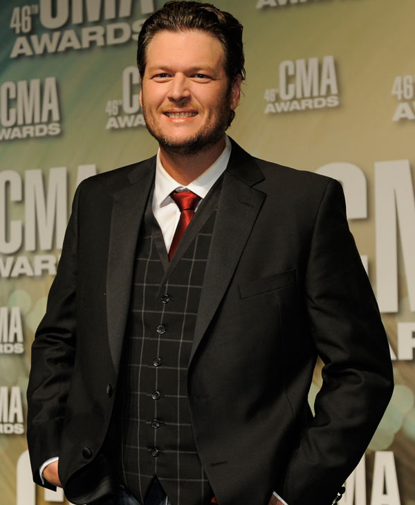"Blake Shelton, winner of the awards for male vocalist of the year, song of the year for ""Over You"" and entertainer of the year, poses backstage at the 46th Annual Country Music Awards at the Bridgestone Arena on Thursday, Nov. 1, 2012, in Nashville, Tenn. (Photo by Chris Pizzello/Invision/AP)"