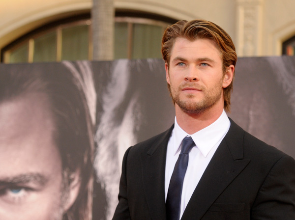 "Actor Chris Hemsworth arrives at the premiere of the feature film ""Thor"" in Los Angeles on Monday, May 2, 2011. (AP Photo/Dan Steinberg)"