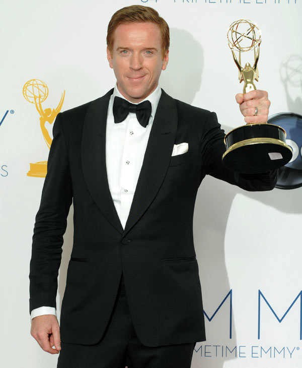 "Actor Damien Lewis, winner Outstanding Lead Actor In A Drama Series for ""Homeland"", poses backstage at the 64th Primetime Emmy Awards at the Nokia Theatre on Sunday, Sept. 23, 2012, in Los Angeles. (Photo by Jordan Strauss/Invision/AP)"