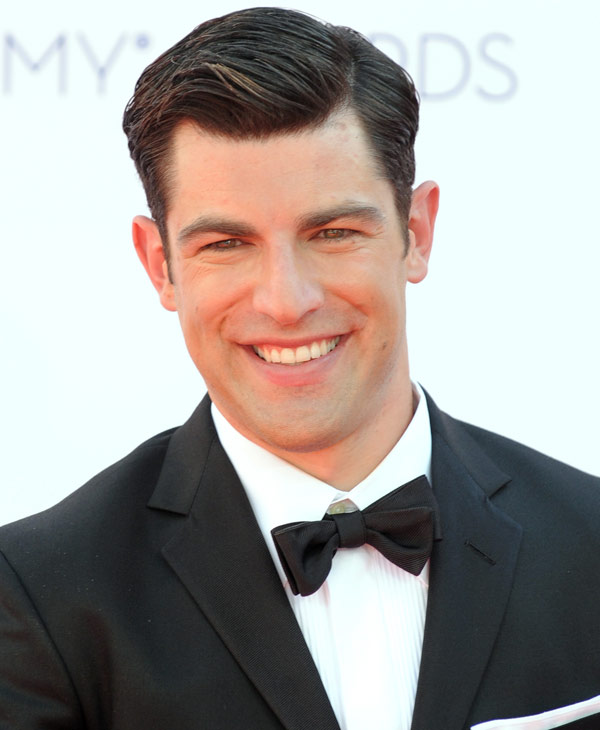 Max Greenfield arrives at the 64th Primetime Emmy Awards at the Nokia Theatre on Sunday, Sept. 23, 2012, in Los Angeles. (Photo by Jordan Strauss/Invision/AP)