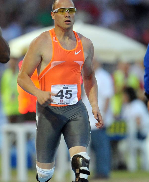 This is a June 4, 2009, file photo showing South Africa's Oscar Pistorius competing in the men's 400 meter event during the 10th memorial Primo Nebiolo international track and field meeting, in Turin, Italy. The prosthetic legs of double-amputee sprinter Oscar Pistorius give the South African a 10-second advantage over a 400-meter race, according to a new study. (AP Photo/Massimo Pinca, File)
