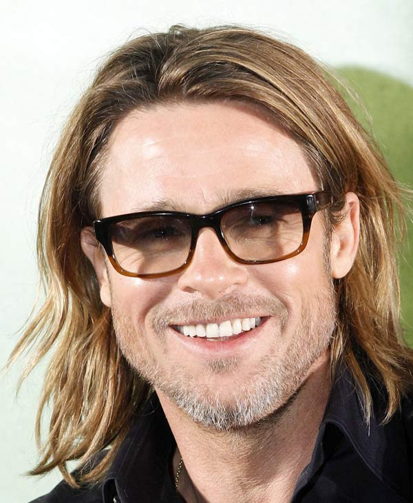 "Sexiest Man Alive 2000:  Actor Brad Pitt smiles during a press conference of his latest film, ""Moneyball,"" in Seoul, South Korea, Tuesday, Nov. 15, 2011. (AP Photo/Lee Jin-man)"