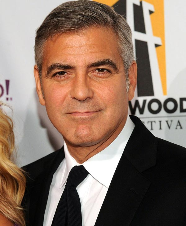 Sexiest Man Alive 2006:  George Clooney arrives at the 15th Annual Hollywood Film Awards Gala on Monday, Oct. 24, 2011 in Beverly Hills, Calif. (AP Photo/Kristian Dowling)