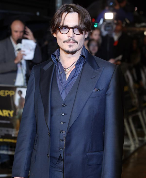 Sexiest Man Alive 2003:  U.S actor Johnny Depp arrives for the European Premiere of The Rum Diary, at a London cinema, Thursday, Nov. 3, 2011. (AP Photo/Joel Ryan)