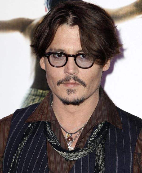 "Sexiest Man Alive 2009:  U.S actor Johnny Depp poses as he arrives for the French Premiere of his movie ""Rum Diary"", in Paris, Tuesday, Nov. 8, 2011. (AP Photo/Thibault Camus)"