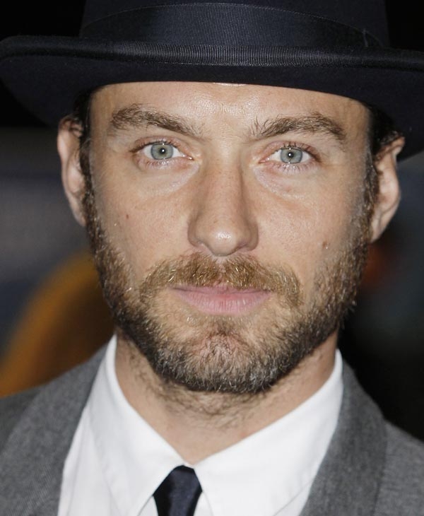 Sexiest Man Alive 2004:  British actor Jude Law arrives on the red carpet for the European Premiere of 360, the opening film for the London Film Festival, at a central London Cinema, Wednesday, Oct. 12, 2011. (AP Photo/Joel Ryan)