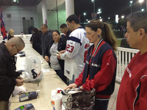 Fans lined up outside Reliant Stadium to get their hands on division championship gear after the exciting win <span class=meta>(Christine Dobbyn)</span>